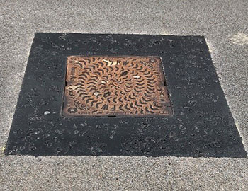 manhole cover set in ironguard