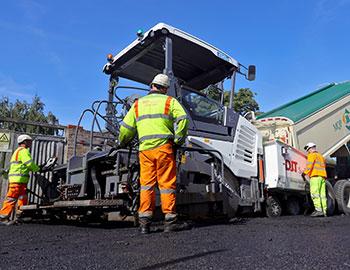 machine laying asphalt with DJT team