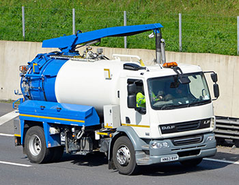 gully cleansing truck on road